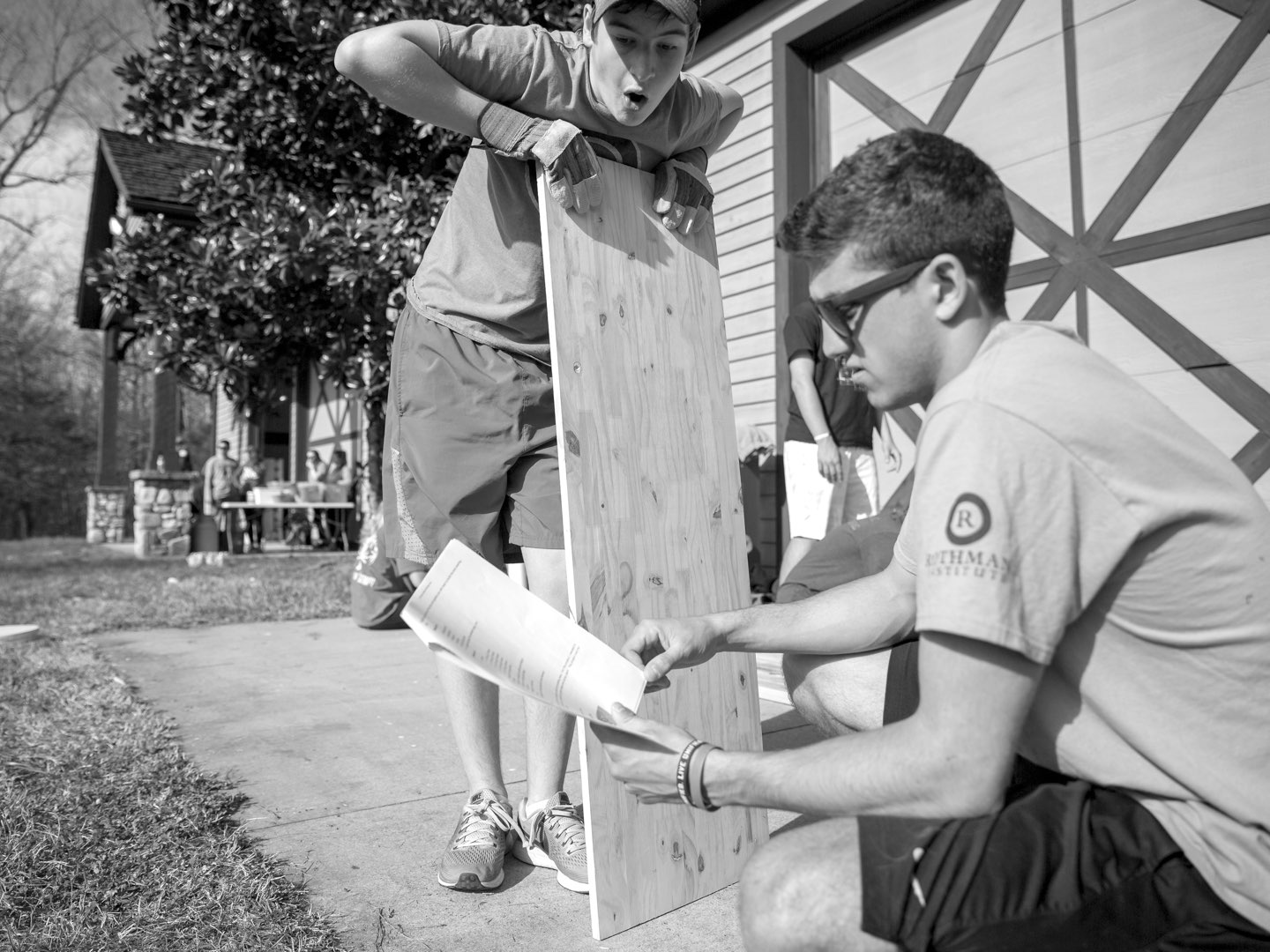 Black-and-white photo of Villanova students working on service project.