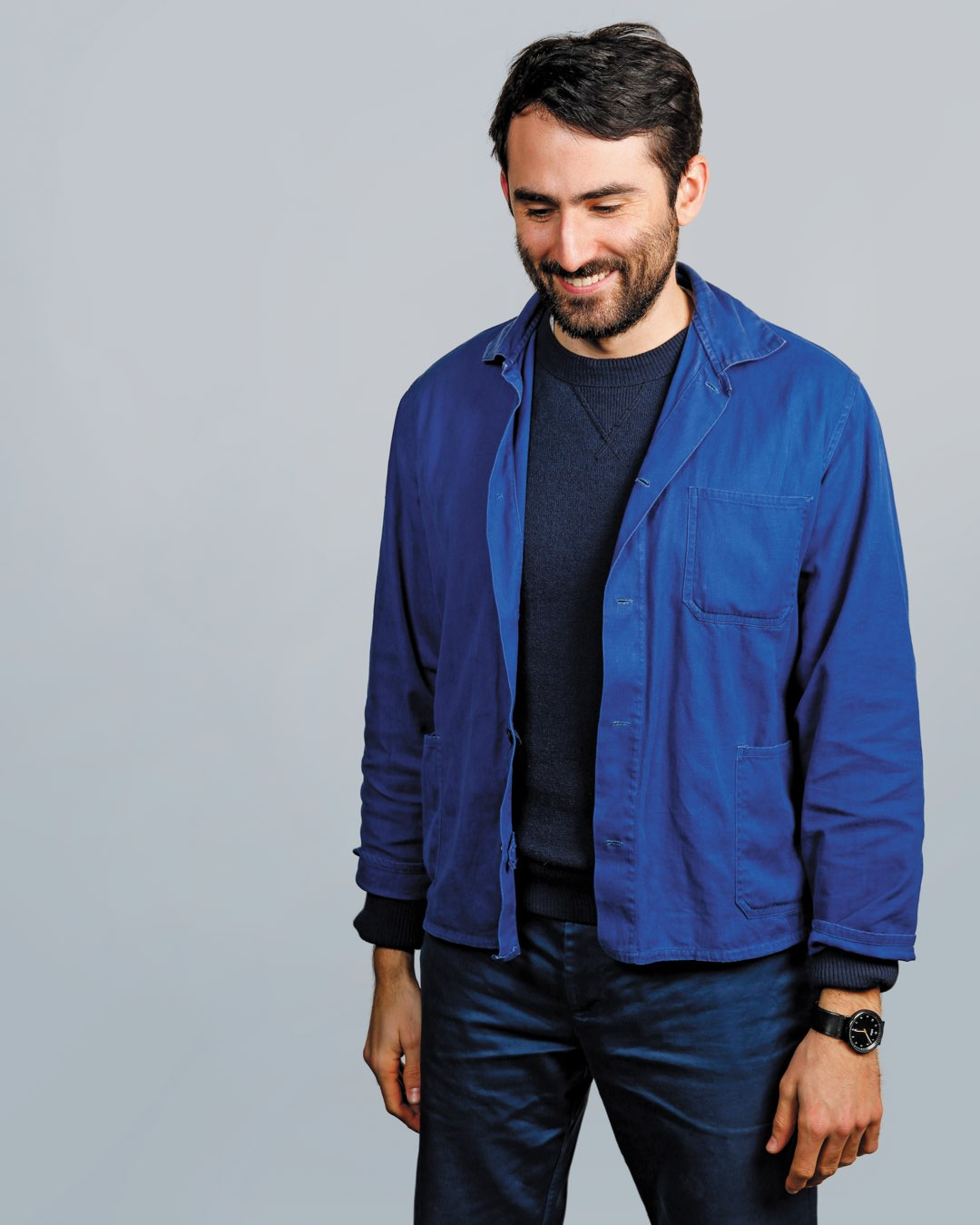 Villanova School of Business alumnus Ryan Burke with a beard in a blue denim button down and jeans