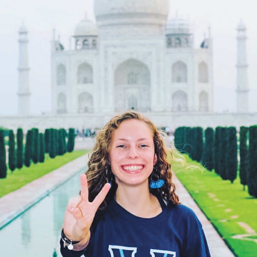 A female Villanova student in a Villanova T-shirt in front of the Taj Mahal in India
