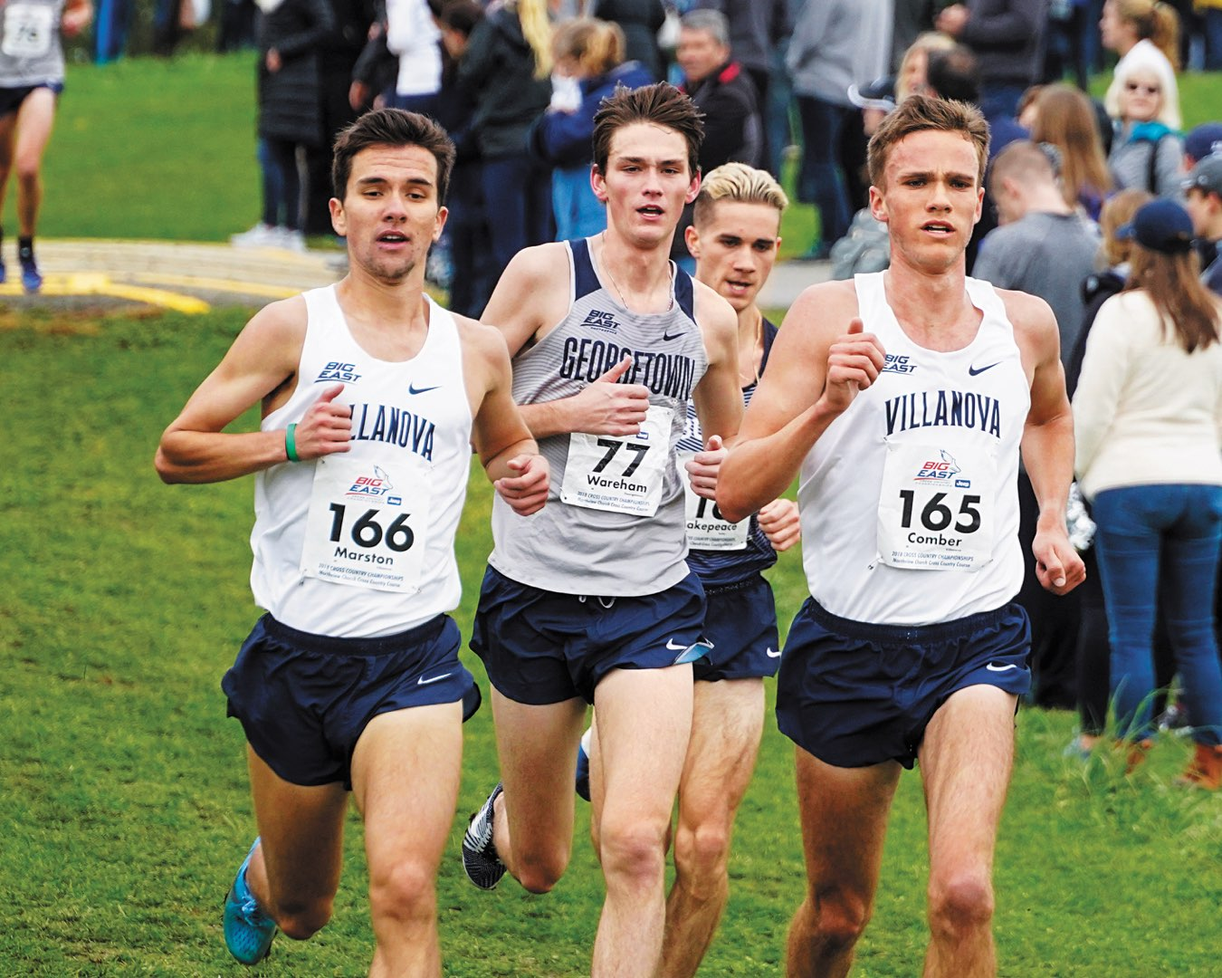 Two Villanova Men's Indoor Track and Field team members running with two other runners close behind them
