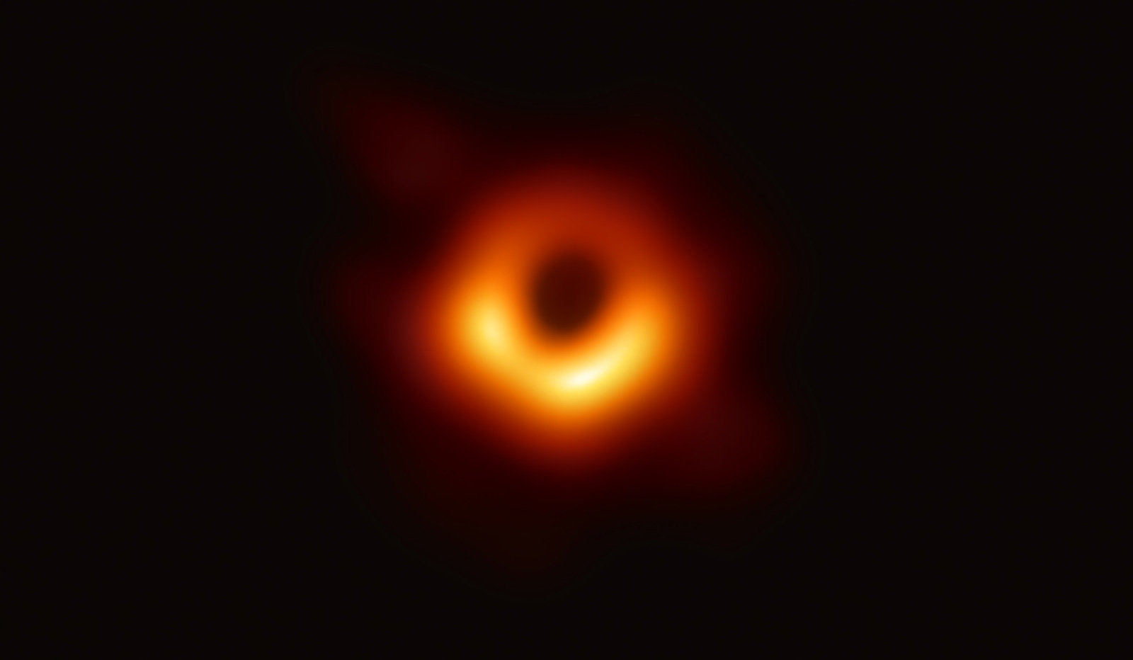Blurry orange ring against a black backdrop
