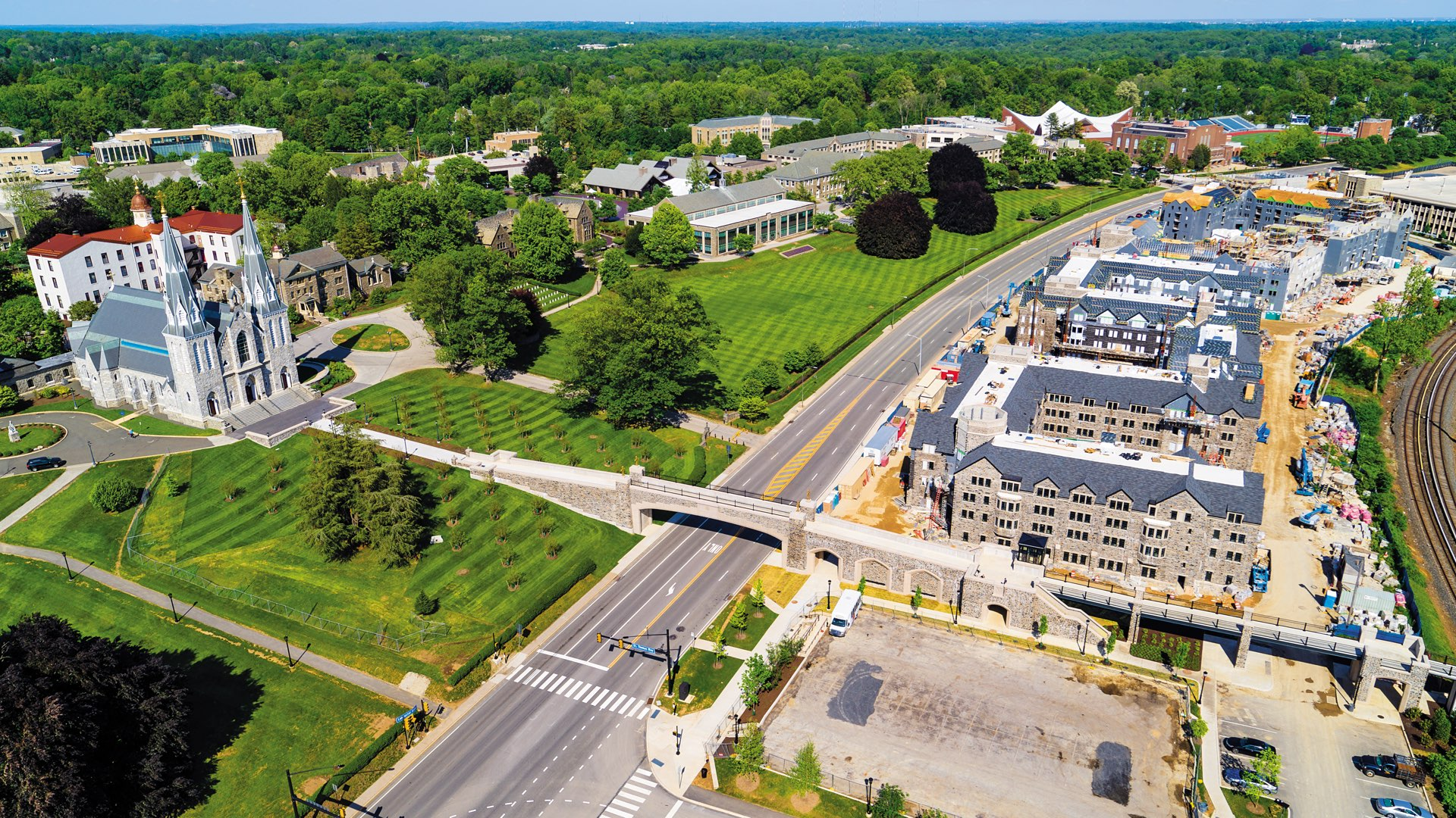 Aerial shot of Lancaster Avenue showing the chapel, main campus, and bridge with new residence halls under construction