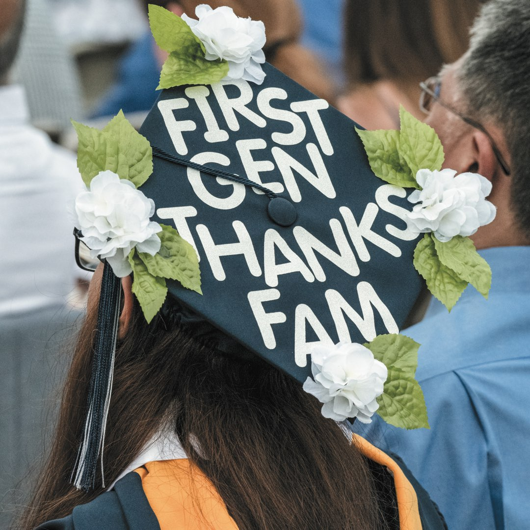 "Cap with white flowers that reads ""First Gen Thanks Fam"""