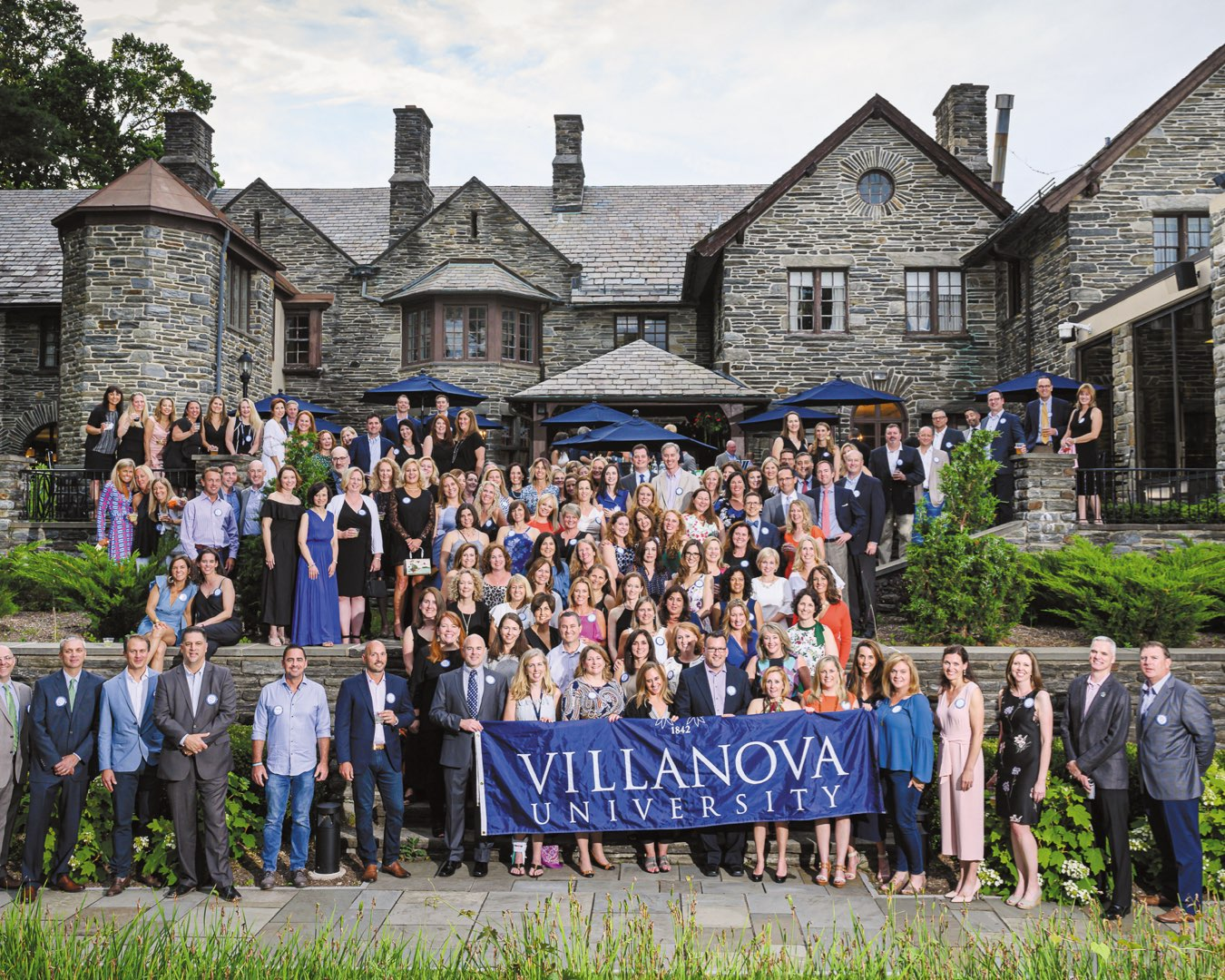 More than 100 alumni on the outdoor stone patio of the Inn at Villanova