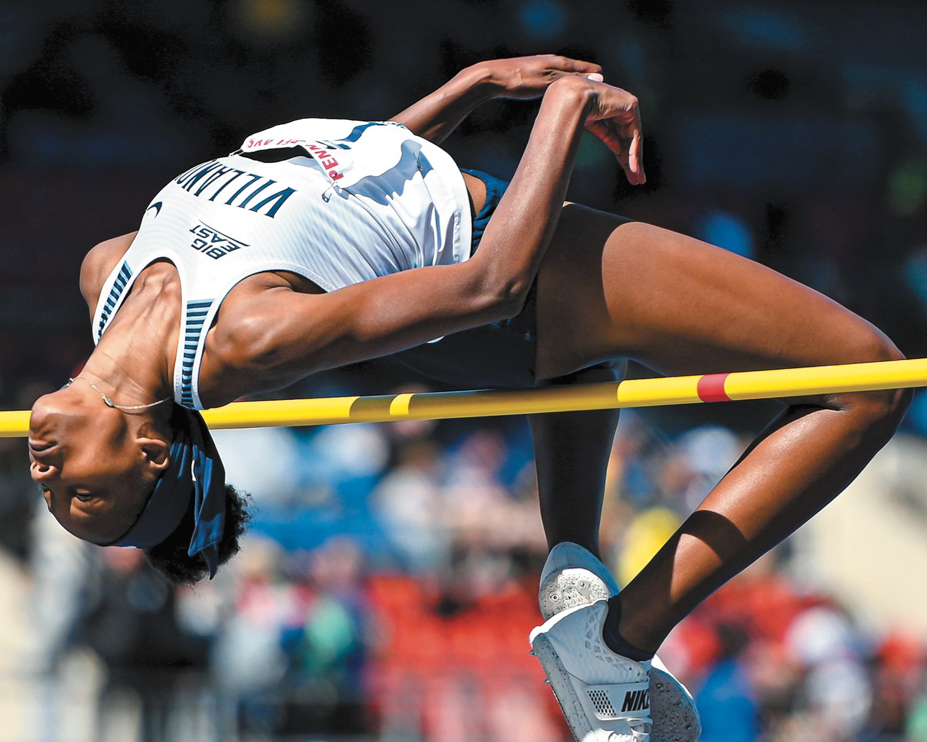 Freshman Sanaa Barnes arched over the yellow high bar in mid jump