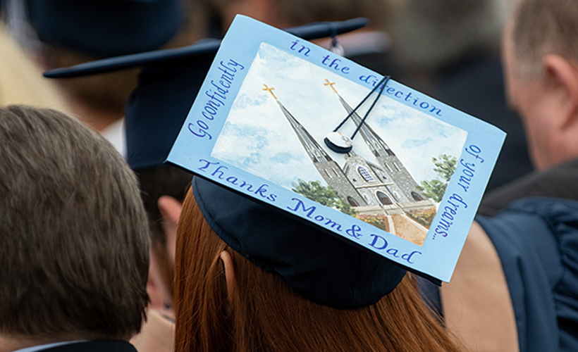 students graduation cap thanking mom and dad