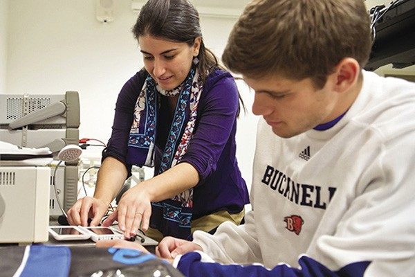 Amal Kabalan, assistant professor at Bucknell University, works with a student in the lab.