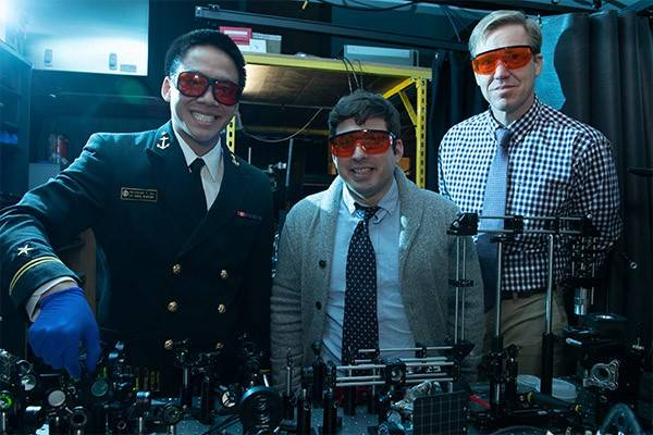 Ronald Warzoha stands with two of his U.S. Naval Academy students in a lab.