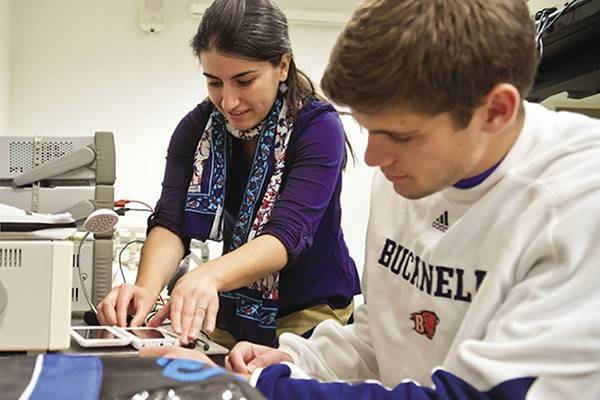 Amal Kalaban, assistant professor at Bucknell University, works with a student in the lab.