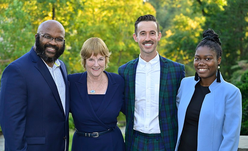 A student works the camera behind the scenes of a news broadcast.