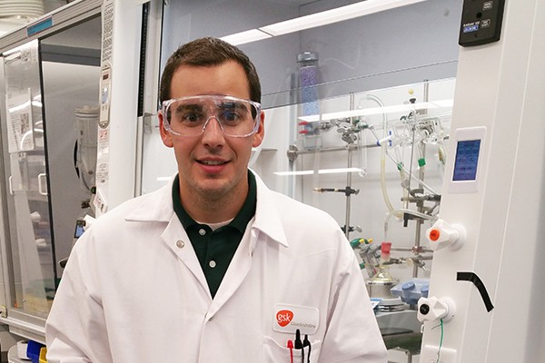 Alex Reif stands in a lab at GlaxoSmithKline.