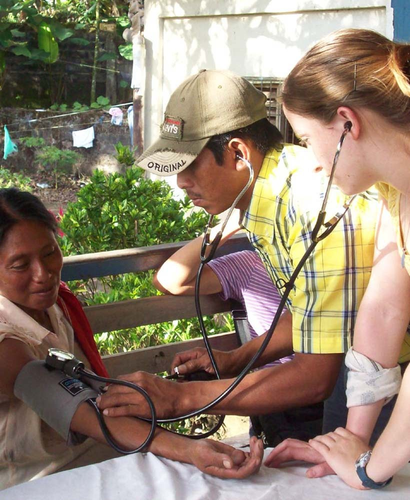 Student listens to blood pressure sounds in Nicaragua.