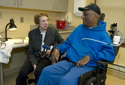 Dr. Smeltzer with patient in wheelchair