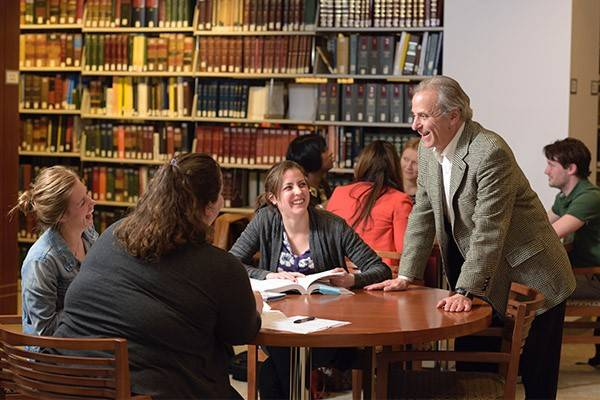 Jonathan Schiffman, JD, a professor in Villanova's Paralegal program, interacts with students in the library.