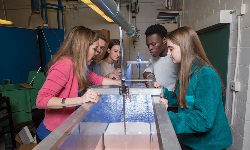 Villanova faculty member working with students in a hydrology and Hydrolics lab.