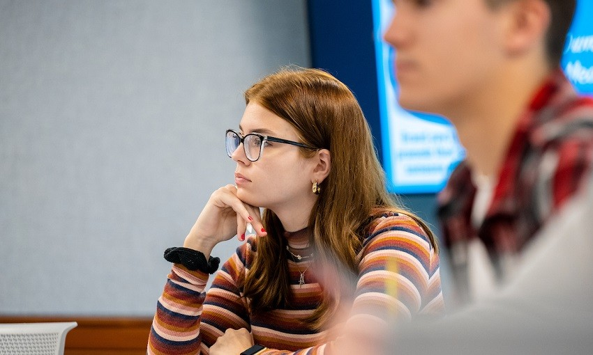 Students and faculty gather to chat on patio