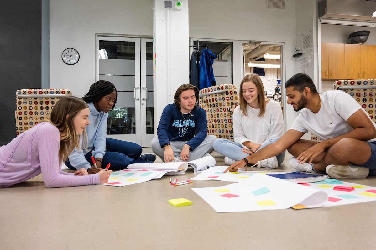 Students stroll through a courtyard of The Commons