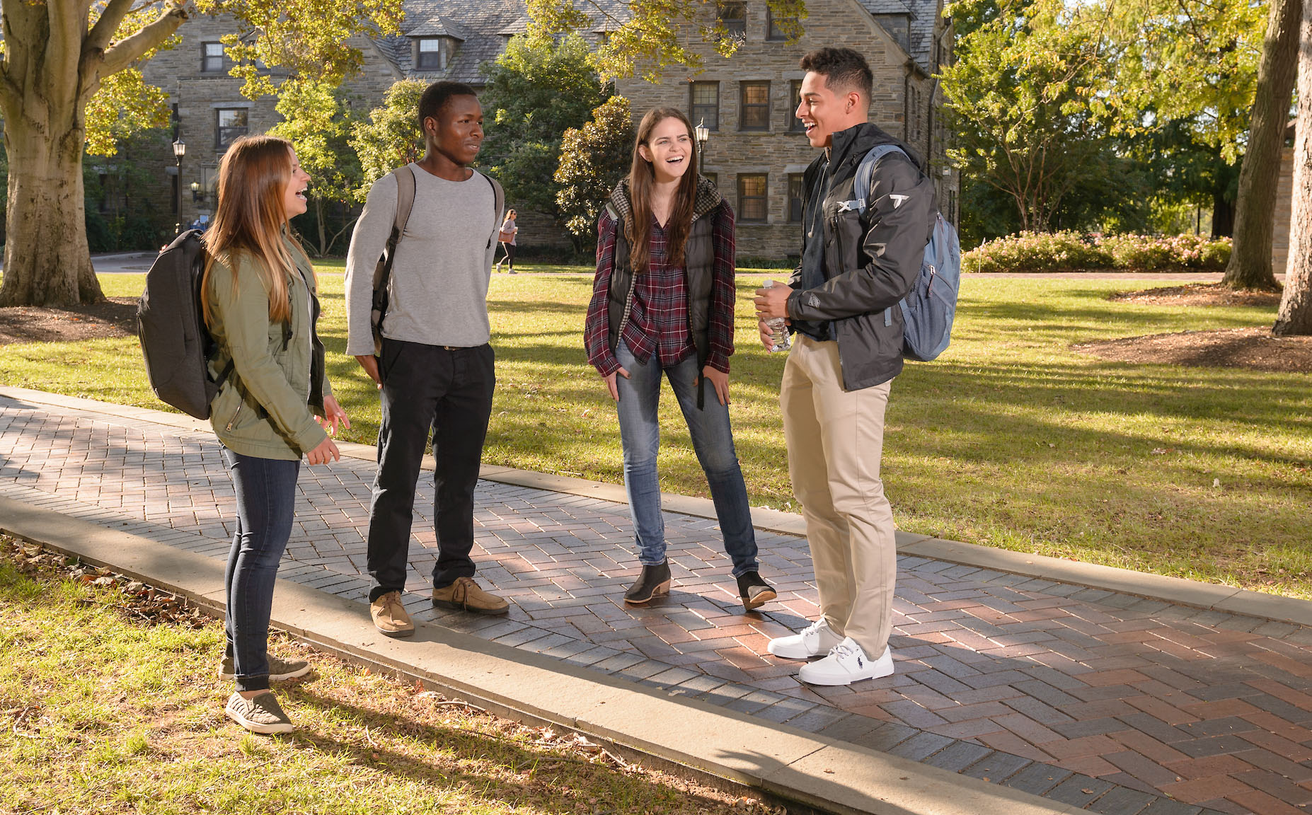 Students laughing near Austin Hall