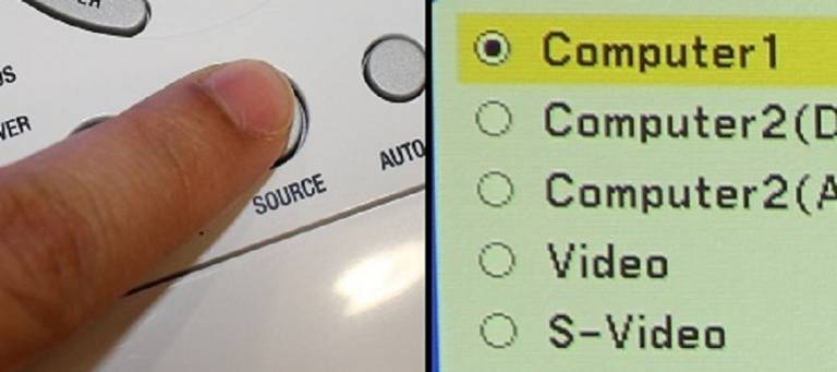 Locate the button on the projector that controls the projector's input, labeled