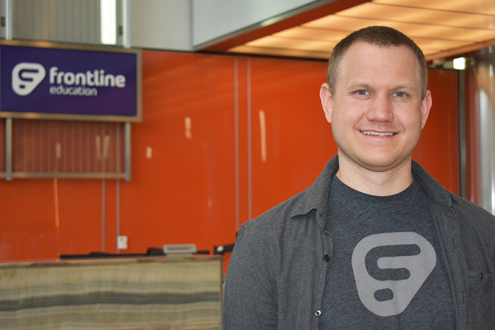Matt Sisco, a Software Engineering master's alumnus, in the lobby of Frontline Education