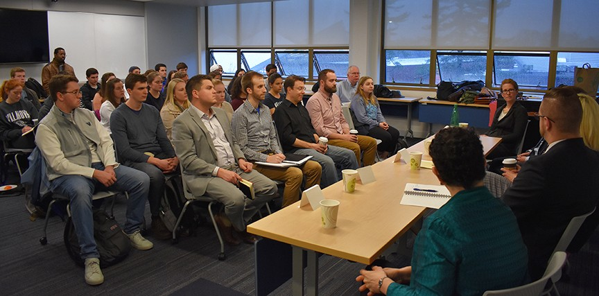 Nearly 40 graduate and undergraduate students packed a classroom for the Political Science career panel
