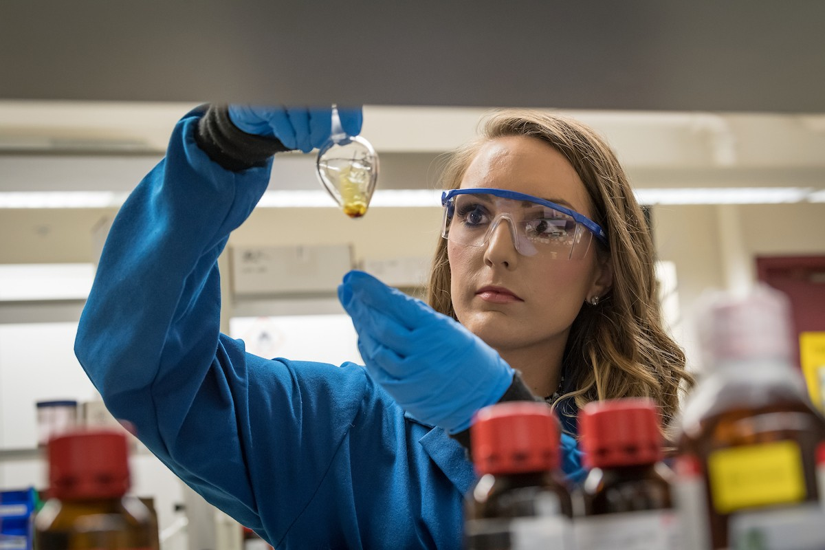 Stephanie Schallenhammer '18 MS inspects chemicals in a lab