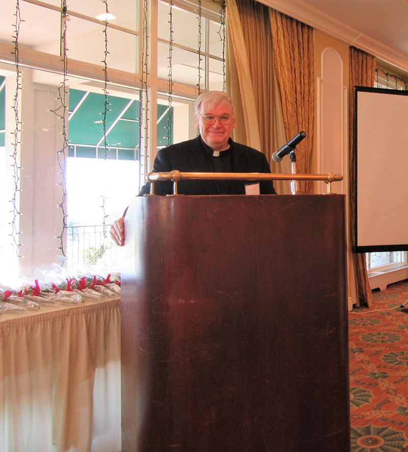Fr  Ryan at Podium.jpg