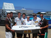 The Villanova team proudly displays its unmanned boat at the first annual International Autonomous Surface Vehicle Competition in San Diego.