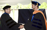 Ronald A. Chadderton, Ph.D., Chair of Civil and Environmental Engineering, congratulates Clay Emerson after the student's Doctor of Philosophy hooding.