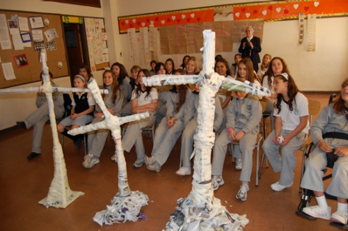 Dr. Dinehart and Abigail led a hands-on engineering project in which students built freestanding newspaper crosses.