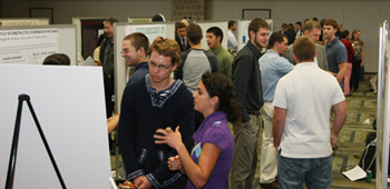 Adrienne (foreground, right) explains her poster at Villanova's Undergraduate Research Poster Day on October 3.