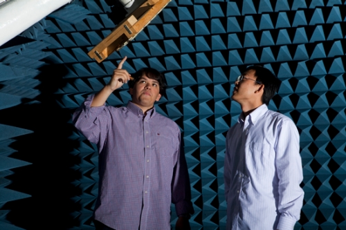 Christopher Thajudeen, left, in the Center for Advanced Communications' Antenna Research Lab.