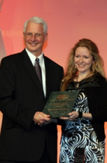 Kenneth C. Hover, President of the American Concrete Institute, presents Dr. Aleksandra Radlinska, Assistant Professor of Civil and Environmental Engineering, with her award.