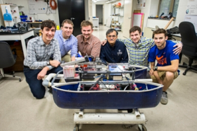 Dr. Nataraj with members of Villanova's Autonomous Surface Vehicle Team