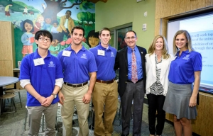 Computer Engineering seniors Kevin Yeom, James Spedick, Matthew Doyle and Emily Kossler (far right), with alumnus Gene Alessandrini '86 EE and his wife Gina.