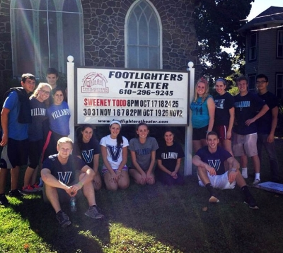 On St. Thomas of Villanova Day of Service, Caroline Franchino '16 ME (standing next to sign, right side) led the volunteer student group at the Footlighters Theater site.