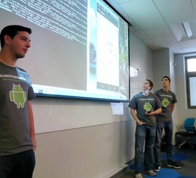 "Demonstrating their ""GoingOn"" app are senior Computer Engineering majors Matt Wiedmeier, Matt Doyle and Ed Condon."