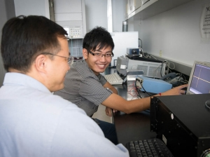 Si Qin with Yimin Zhang, CAC research professor.