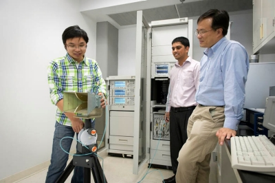 Qisong Wu, PhD, post-doctoral research fellow; and PhD student Saurav Subedi, with advisor Yimin Zhang, PhD.