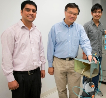 Doctoral candidate and CAC research assistant Saurav Subedi with Research Professor Yimin Zhang, PhD, and doctoral candidate Si Qin.