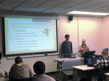Members of the Mobile Histiotics Corp. team present their idea for Electromagnetic Field Therapy.