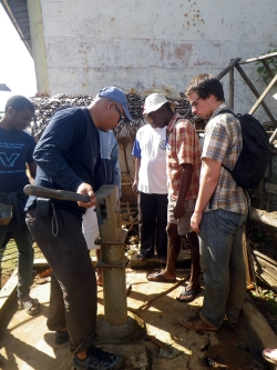 Sean Carney '16 ME works with CRS engineer Hery Lanto Rasaonina to dismantle and examine a broken hand pump.