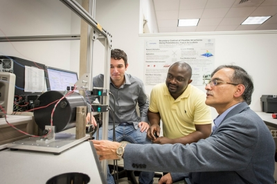 PhD candidate Dimitrios Karagiannis with postdoctoral fellow Cedrick Kwuimy, PhD, and C. Nataraj, PhD, professor of Mechanical Engineering and the Mr. and Mrs. Robert F. Moritz, Sr. Endowed Chair in Systems Engineering.