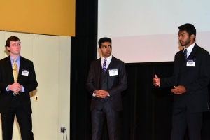 Juniors Matthew Myers CpE, Sanjit Singh EE and Shawn Vettom CpE present Vivify to VSEC judges; their app took third place.