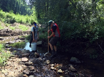 Graduate student Emily Carambelas and Dr. Stan Kemp, the project's co-PI from the University of Baltimore, conduct stream sampling.