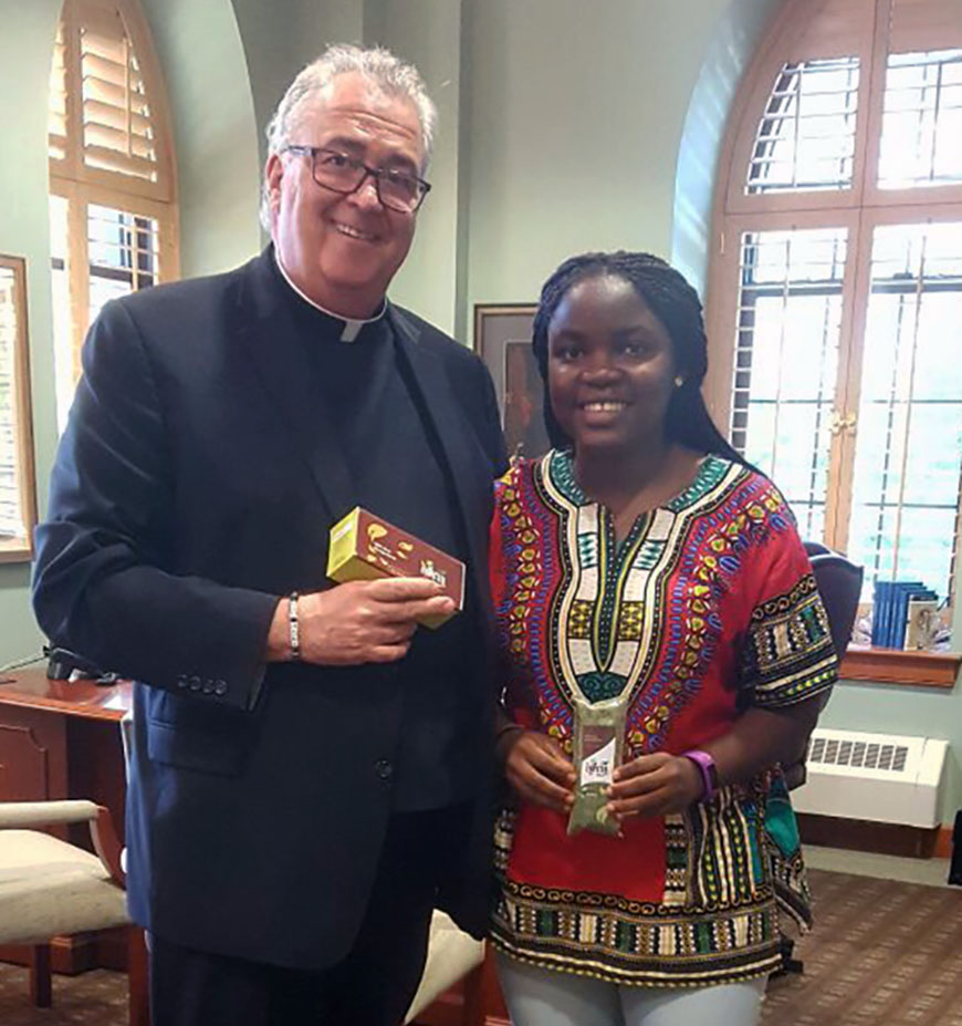Rev. Peter M. Donohue, OSA, PhD, President, Villanova University with Chemical Engineering graduate student and Afya Tea founder Vanessa Kungne.