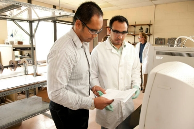 Assistant Professor of Chemical Engineering Justinus Satrio, PhD, works with then-doctoral student Rene Garrido, PhD, in the College's Biomass Resources & Conversion Technologies Lab.