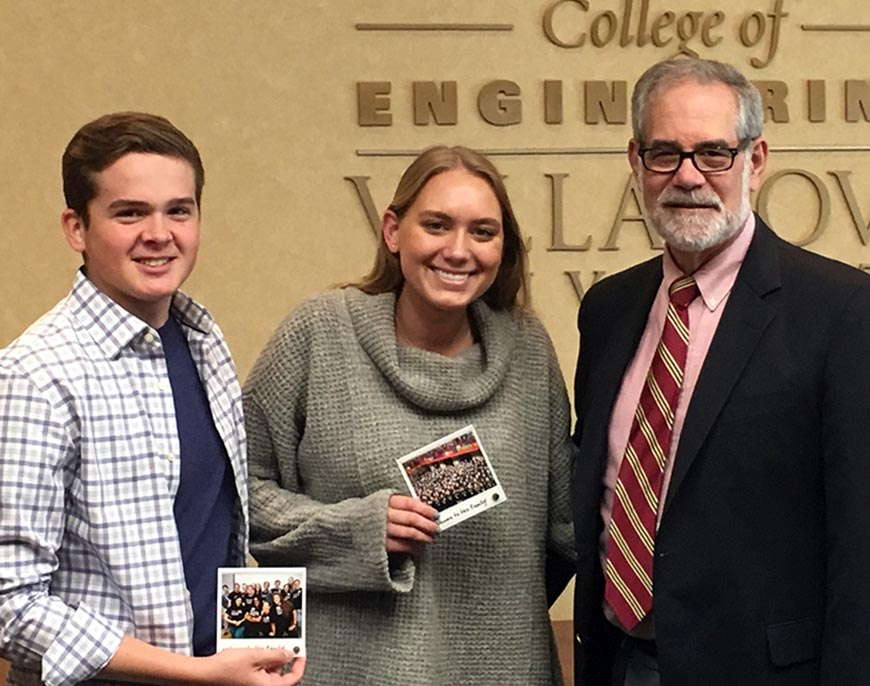 Mechanical Engineering sophomores Albert Tebbetts and Lauren Atkins are congratulated by Villanova's Drosdick Endowed Dean Gary A. Gabriele, PhD.