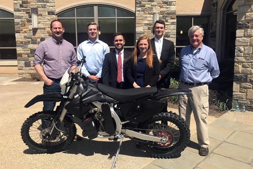 Sponsor Steve Christini '95 ME with members of the Christini Electric Hybrid AWD Motorcycle team and team advisor Dr. Philip McLaughlin, professor emeritus.