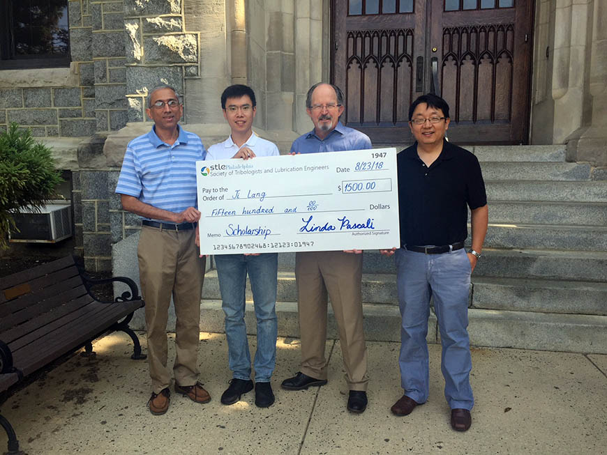 Mechanical Engineering Department Chair and Professor Dr. Sridhar Santhanam with scholarship recipient Ji Lang; Thomas O'Brien, representing STLE; and Associate Professor Dr. Qianhong Wu, who serves as Ji's advisor.